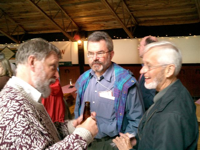 L to R - David Feeny, Bill Furlong, George Torrance comparing notes at the International Society for Technology Assessment in Health Care - ISTAHC, June 2003, Canmore AB, Canada