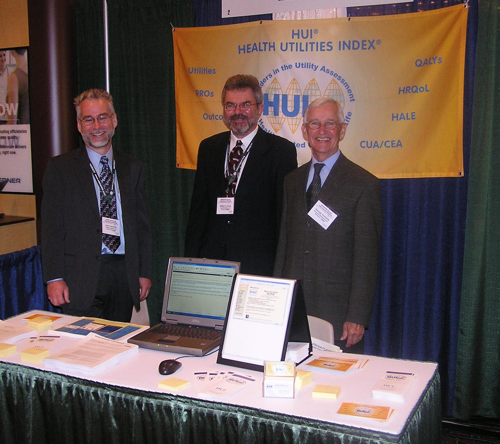L to R - John Horsman, Bill Furlong, George Torrance at the HUInc Booth, International Society for Pharmacoeconomics and Outcomes Research - ISPOR, May 2003, Arlington, VA, USA.